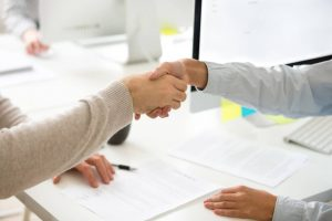 Man and woman shaking hands with licensed money lenders